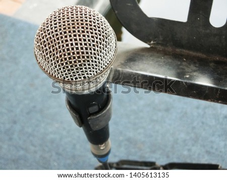 classic single microphone in the blur background indoor. open mic for public speech and entertainment. #1405613135
