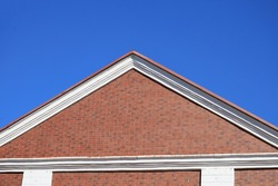 Classic slope of the roof of a brick house. Symbolic and conceptual background with copyspace for text or inscription
