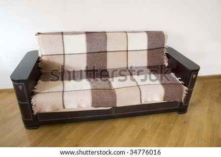 classic sofa covered by rug on the wooden floor