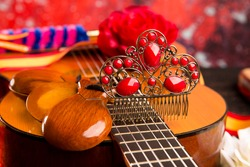 Classic spanish guitar with flamenco elements as comb and castanets