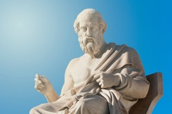 classic statue of Greek philosopher Plato while sitting