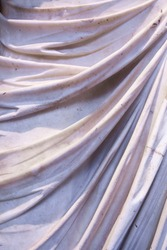 Classic statue sculpted with wet-drapery tecnique. Clothes appears in folds while it reveals the contours of the form beneath