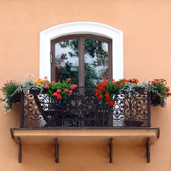 Classic style balcony with flowers at summer time