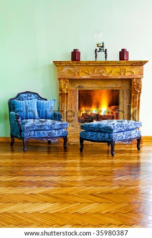 Classic style blue armchair and leg rest