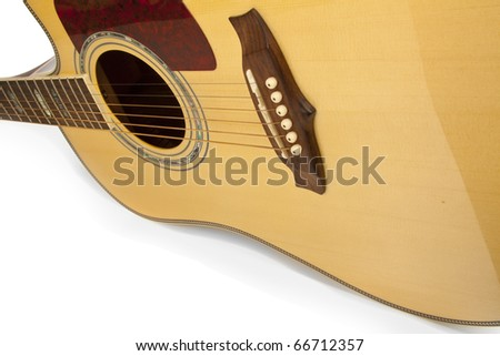 Classic styled guitar shot at an angle on white - stock photo