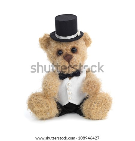 Classic teddy bear gentleman sitting on white
