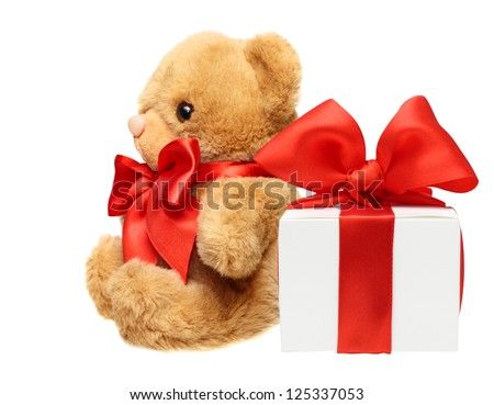 Classic teddy bear with red bow and present box isolated on white background