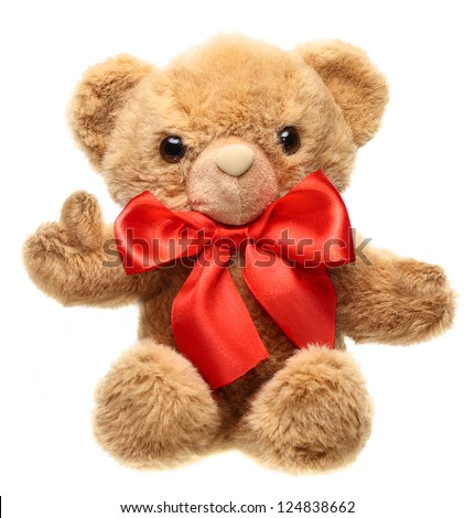 Classic teddy bear with red bow with  thump up isolated on white background