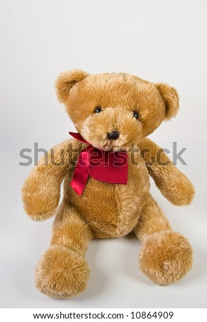 Classic teddy bear with red heart isolated on white background