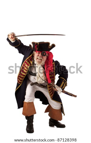 Classic 18th century bearded pirate captain lunging forward with raised sword in challenging pose. Isolated on white background with plenty of room for copy.