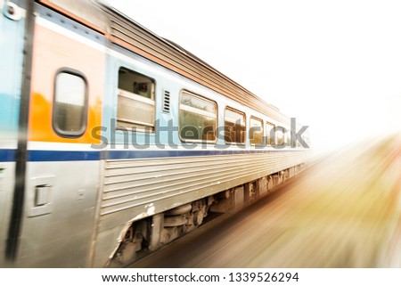 Classic train in motion with sunset. motion blur effect.  #1339526294