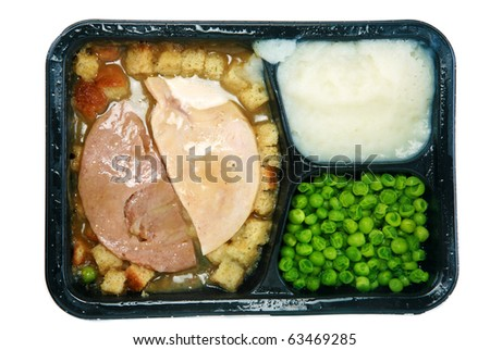 "Classic Turkey and Stuffing ""TV Dinner"" in its black plastic tray, isolated on white with room for your text"