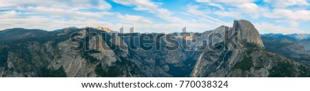 Classic Valley view of Half dome from Glacier point.  Yosemite National Park, California. The must-go attraction for tourists visiting California.