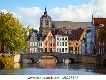 Classic view of channels of Bruges. Belgium. Medieval fairytale city. Summer urban landscape.