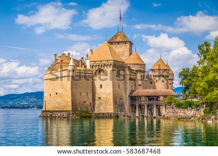 Classic view of famous Chateau de Chillon at beautiful Lake Geneva, one of Switzerland's major tourist attractions and most visited castles in Europe, on a sunny day in summer Canton Vaud, Switzerland #583687468