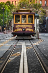 Classic view of historic Cable Car riding on famous California Street on a beautiful sunny day in summer, central San Francisco, California, USA