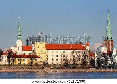 Classic view of Old Riga in Latvia. President Palace in a front, Riga Cathedral in the right side and also river of Daugava with quay.