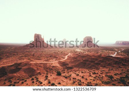 Classic view of scenic Monument Valley with the famous Mittens and Merrick Butte in summer with retro vintage Instagram style filter effect, Arizona, USA