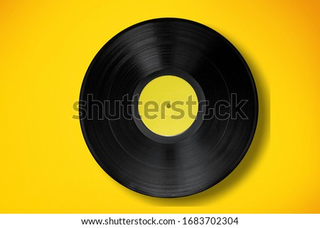 Classic vinyl record on a colored background. Foto stock ©