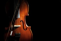 Classic violin and bow on black background. Space for text