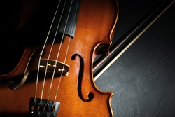Classic violin and bow on stone table, closeup