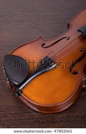 classic violin closeup on a brown wooden background