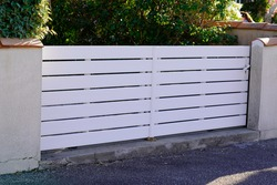 classic white pvc plastic home gate portal of suburbs house door in city