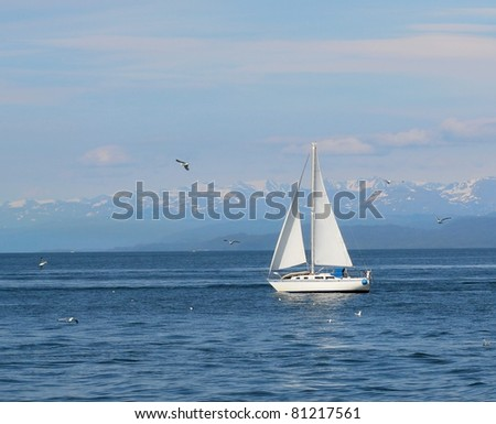 Classic white sailboat in the bay on a sunny summer day in Alaska