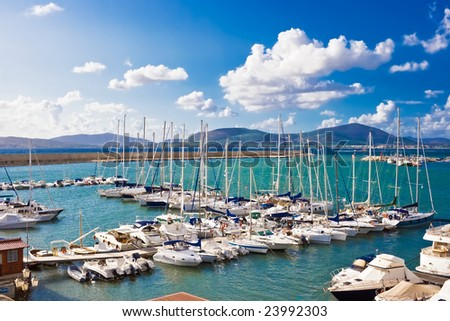 Classic white yachts anchored in the port of Alghero, Sardinia #23992303