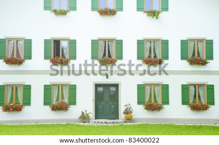 Classic window and door on white wall.