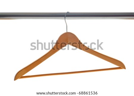 Classic wood clothes hanger hanging on a chrome plated coat closet bar isolated on white