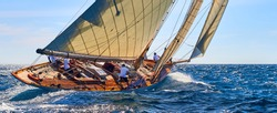 Classic yacht under full sail at the regatta. Sailing yacht race