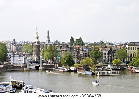 Classical Amsterdam view at the harbor from Amsterdam in the Netherlands