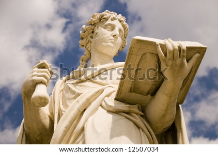 Classical antic greek statue of woman with the book