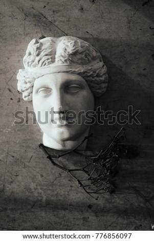 Classical Aphrodite and Venus sculpture mask black and white monochrome photo