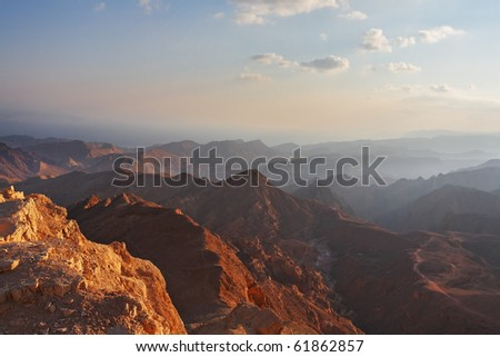 Classical bible landscape - desert Sinai in a morning fog and Red sea