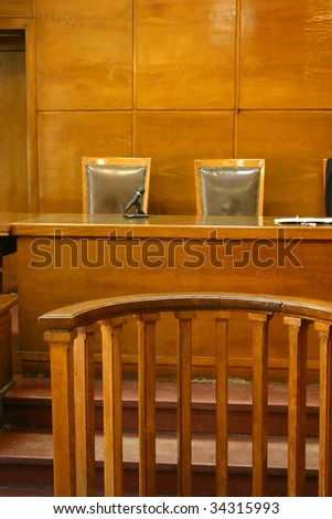 Classical court room with 2 chairs, wooden bench and interior.