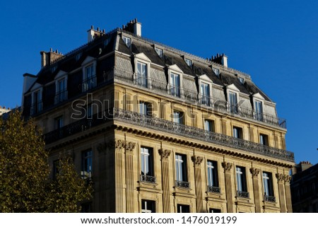Classical facades of Parisian buildings and blue sky. Paris, France. #1476019199
