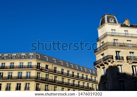 Classical facades of Parisian buildings and blue sky. Paris, France. #1476019202