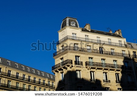 Classical facades of Parisian buildings and blue sky. Paris, France. #1476019208