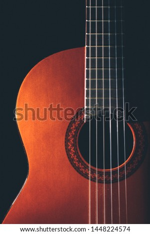 Classical Guitar, An wooden string instruments with string made of gut or nylon