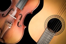 classical guitar and violin, isolated on black