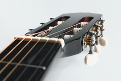 Classical guitar fretboard on white background, guitar