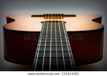 Classical guitar lying flat vignette