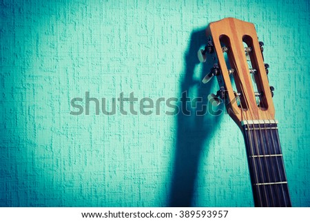 classical guitar on wallpaper...