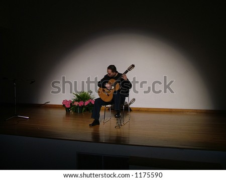 Classical guitarist performing on stage