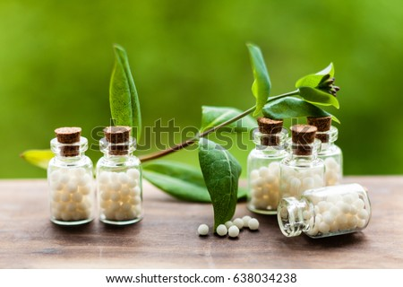 Classical Homeopathy globules in vintage bottles and nature leaves Stock photo ©