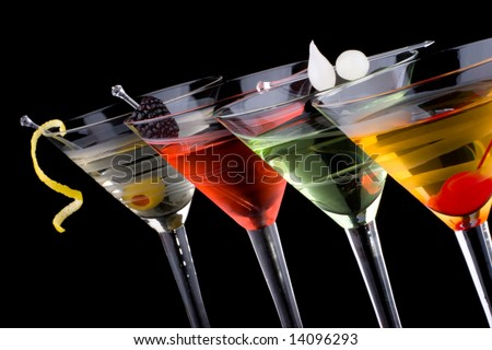Classical martini in chilled glass over black background on reflection surface, garnished with fresh blackberry, maraschino cherry, marinated pearl onions, olive and lemon twist.