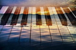 classical music background photo double exposure of piano keys and sunset of a sea landscape