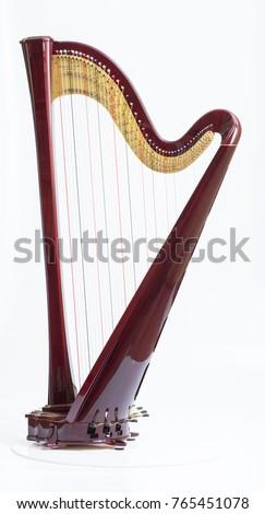 Classical music instrument. Pedal harp #765451078